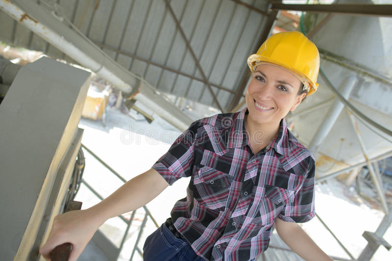 Closeup portrait smiling female construction worker at site royalty free stock photo