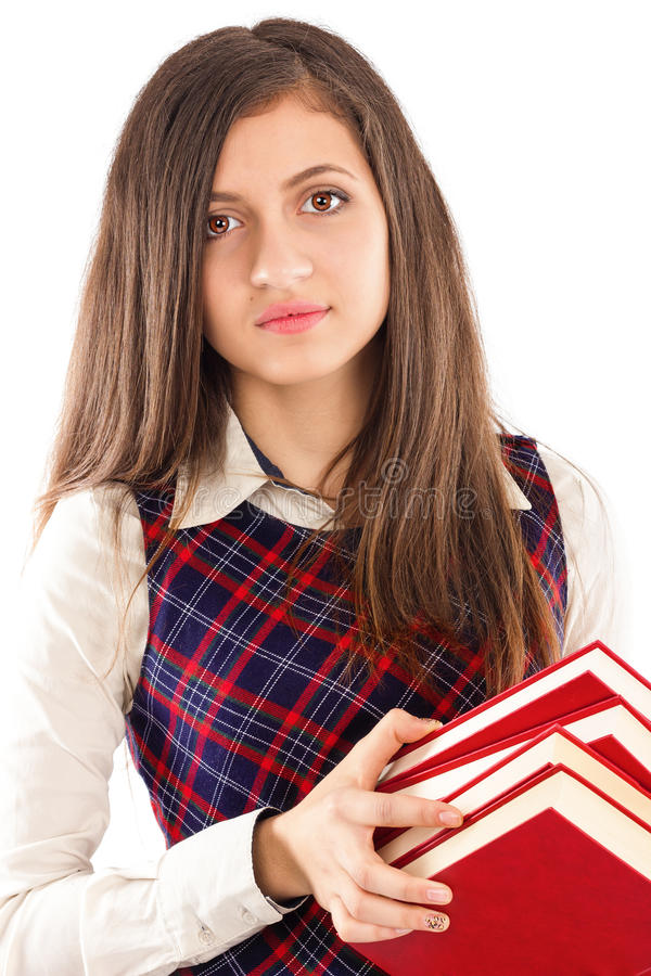 Closeup portrait of student holding a pile of books stock photography