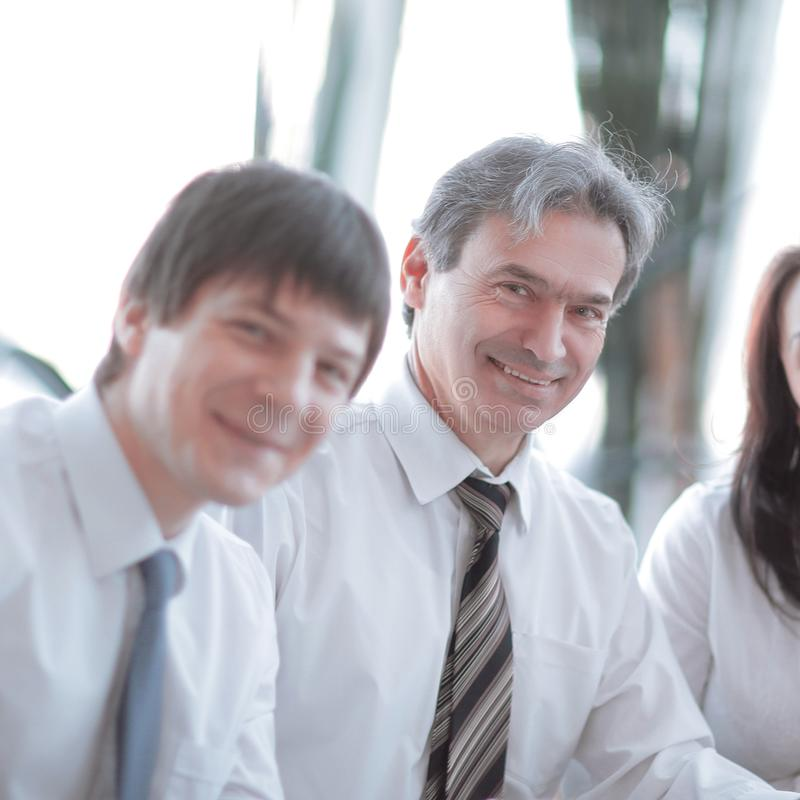 Closeup. portrait of successful business team sitting at their Desk stock photos