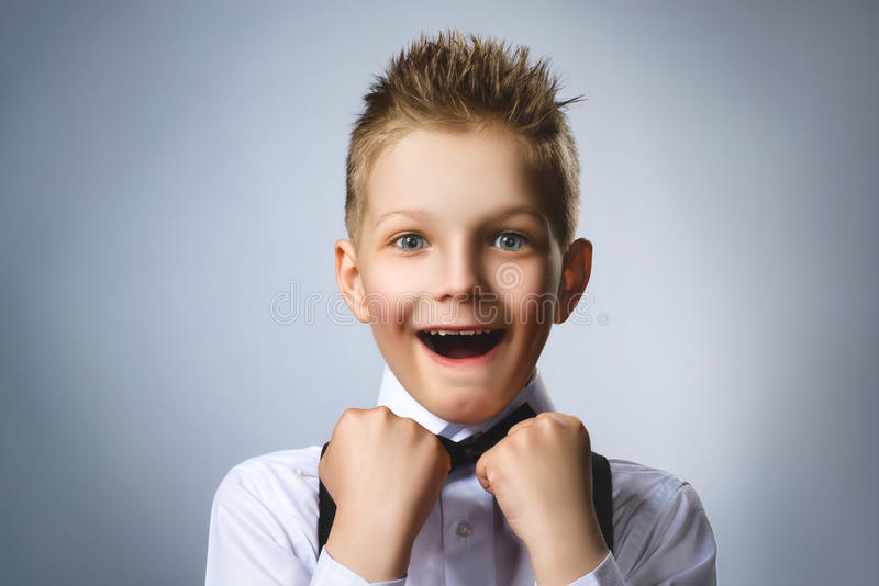 Closeup portrait successful happy boy grey background. Positive human emotion face expression. Life perception stock photography