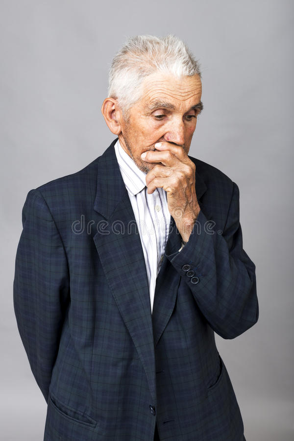 Closeup portrait of thoughtful old man royalty free stock photos