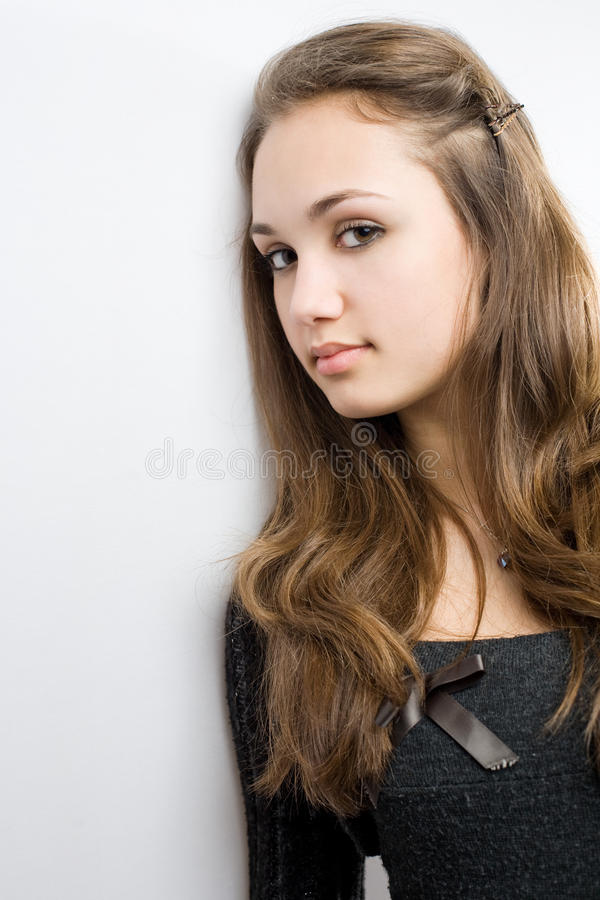 Closeup portrait of very cute young brunette stock image