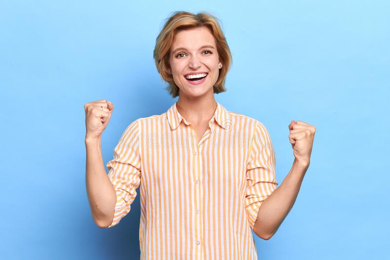 Closeup portrait of winning successful young girl rejoicing her victory, royalty free stock images