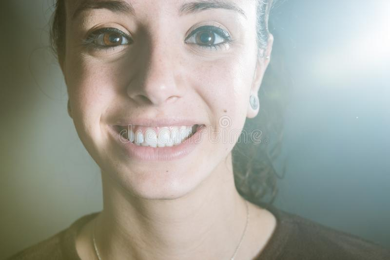 Closeup portrait of a woman and her clean and beutiful smile showing the white teeth stock photo