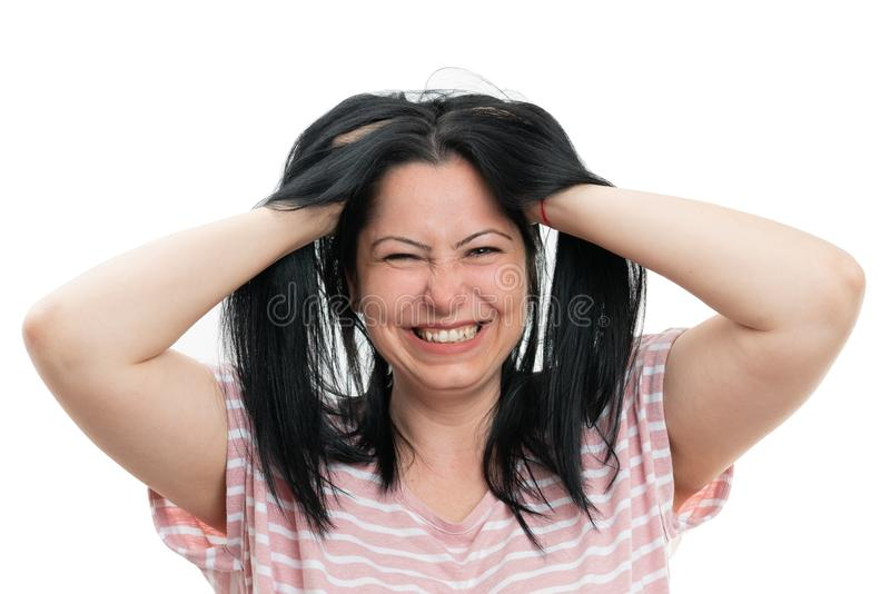 Closeup portrait of woman holding hair stock images
