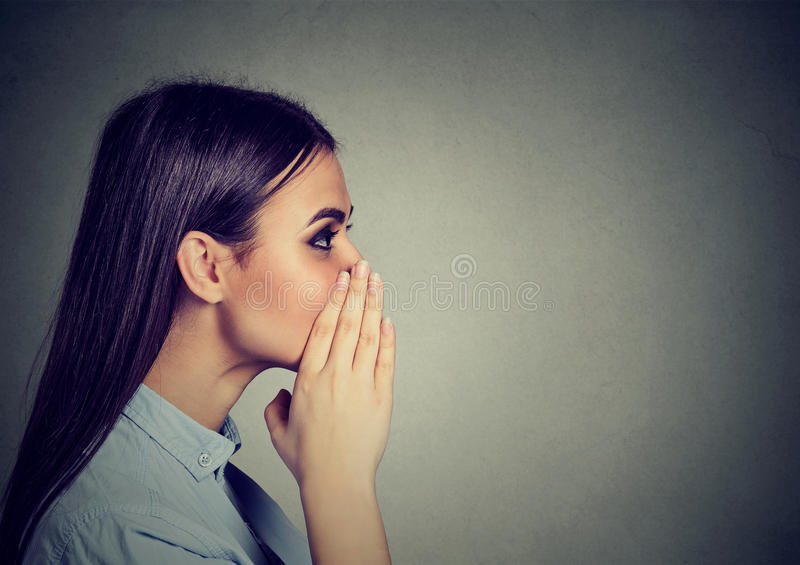 Closeup portrait of a woman whispering a gossip stock image