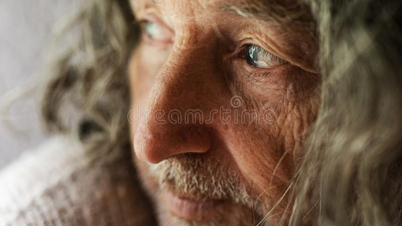 Closeup portrait of a wrinkled senior man royalty free stock images