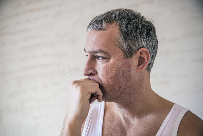 Closeup portrait, young adult man, sad depressed, stressed, alone, disappointed, gloomy, hand covering face. frustrated young ha royalty free stock images