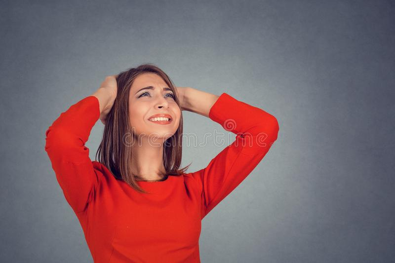 Angry woman covering ears looking up stop loud noise stock photos