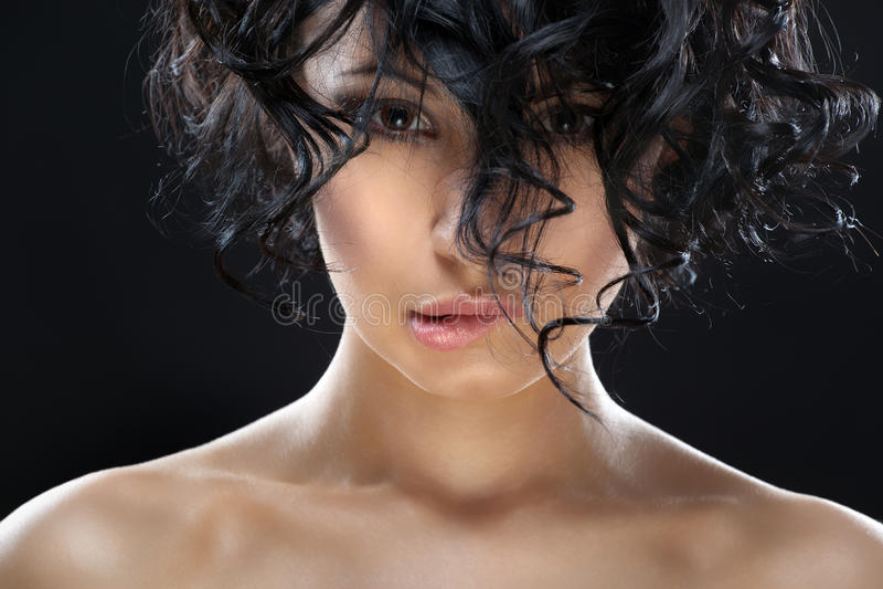 Closeup portrait of a young beautiful woman. stock photos