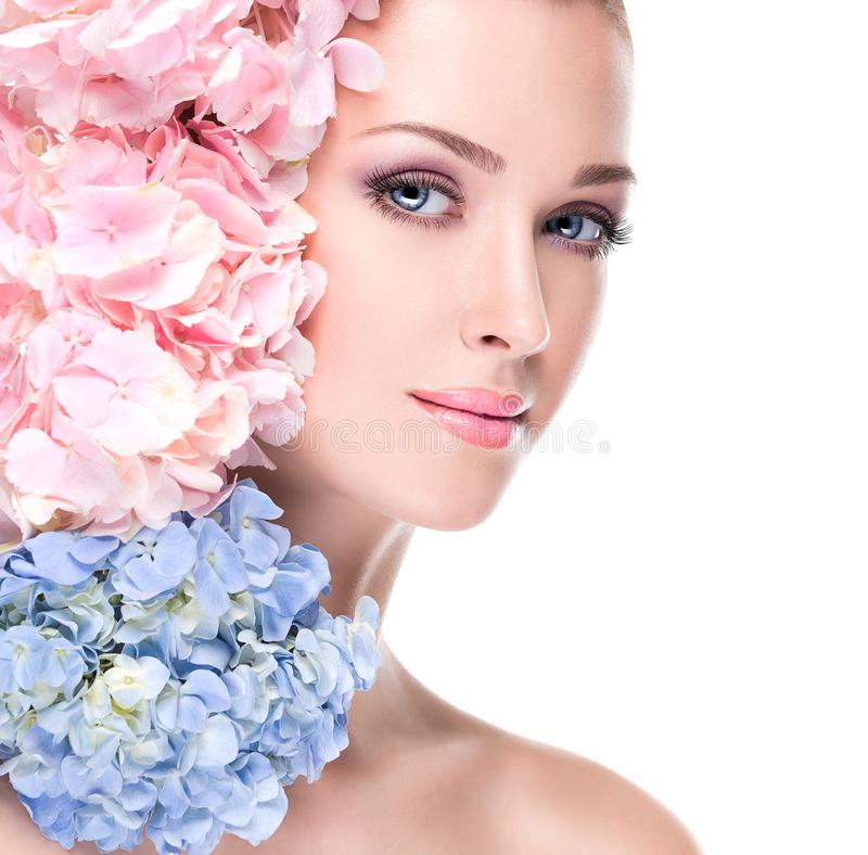 Portrait of young beautiful woman with a healthy clean skin of the face royalty free stock photos