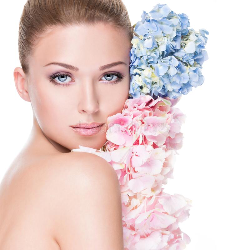 Portrait of young beautiful woman with a healthy clean skin of the face stock photography