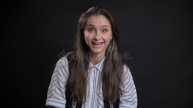 Closeup portrait of young cute caucasian female with brunette hair getting excited and smiling happily while looking royalty free stock images