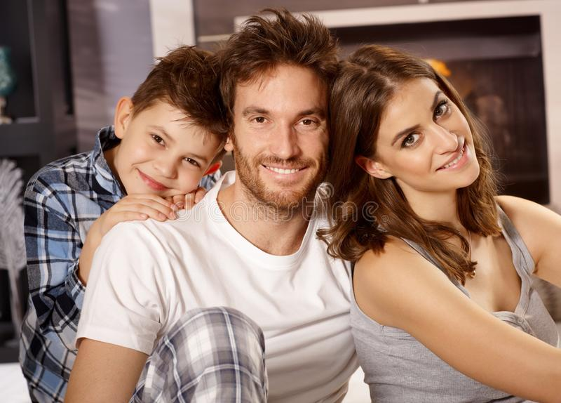 Closeup portrait of young family. Closeup portrait of happy young family with little boy, smiling, looking at camera royalty free stock image