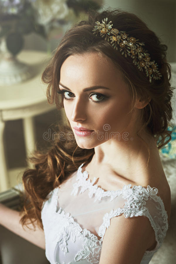 Closeup portrait of young gorgeous blonde bride. Glamour makeup royalty free stock photo