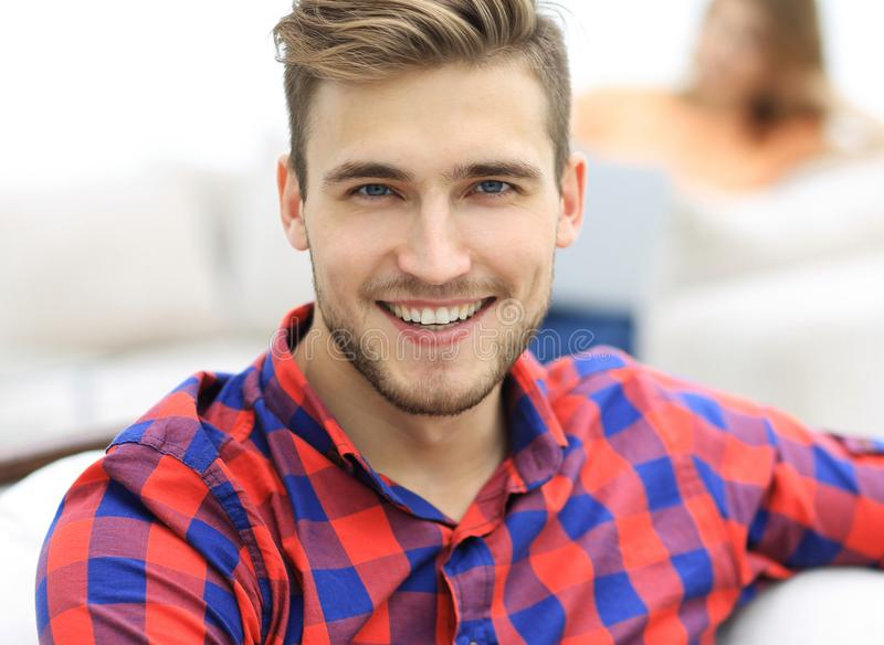 Closeup portrait of young man sitting in a chair stock photo