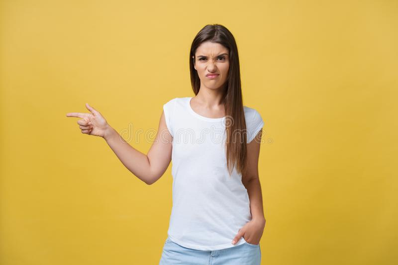 Closeup portrait of young pretty unhappy, serious woman pointing at someone as if to say you did something wrong, bad stock photos