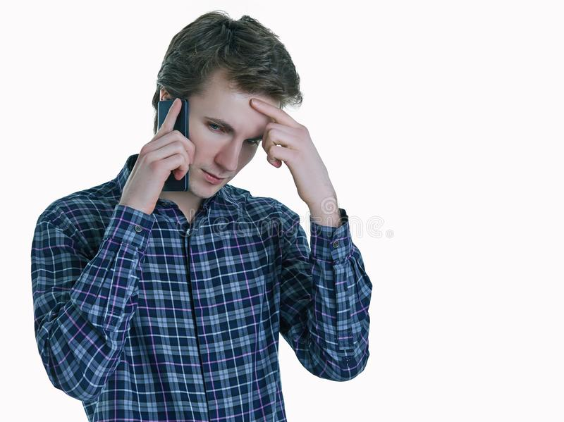 Closeup portrait of young, serious business man, corporate employee, student talking on cell phone. stock photo