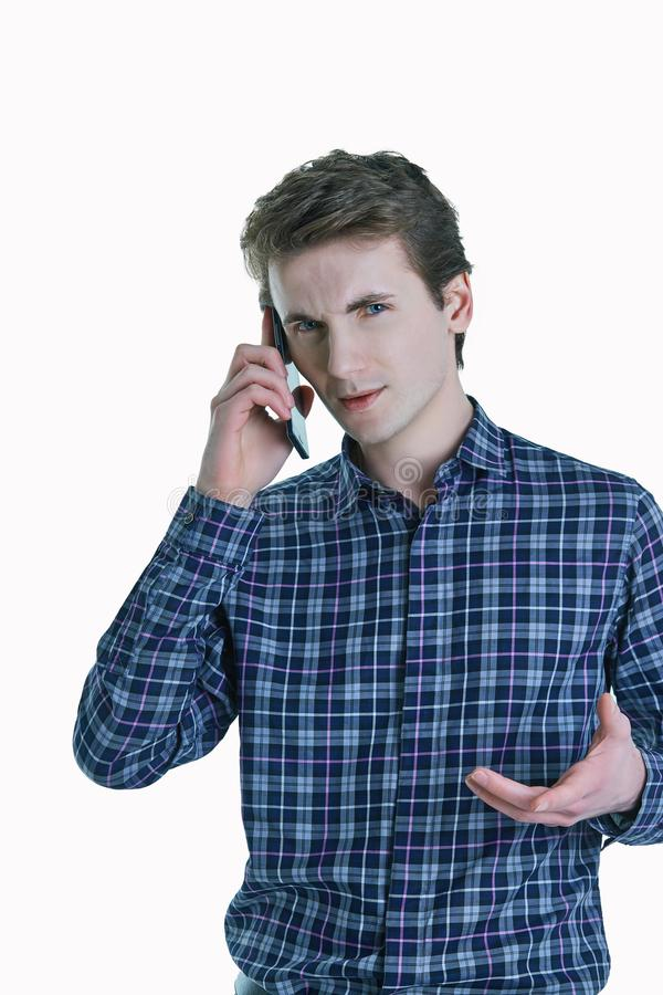 Closeup portrait of young, serious business man, corporate employee, student talking on cell phone. stock photos