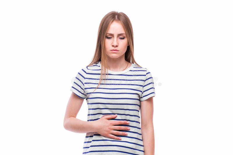 Closeup portrait of young unhappy, annoyed, sick woman about to chuck, throw up, retch barf, hurl. Isolated on white background stock photo