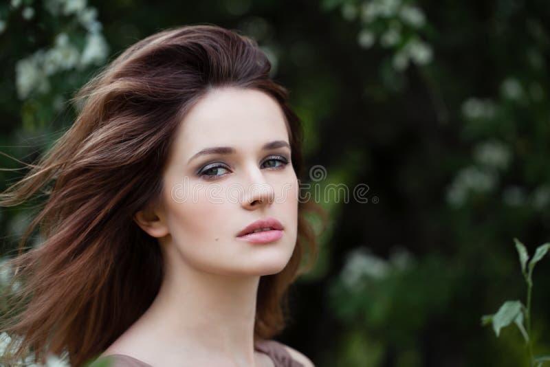 Closeup portrait of young woman face outdoors stock photos