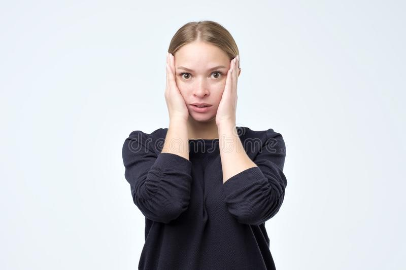 Closeup portrait of young woman looking shocked in full disbelief isolated on grey wall background. royalty free stock images