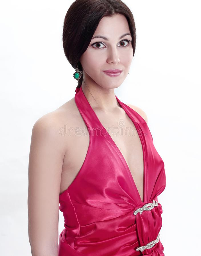 Closeup . portrait of a young woman in a red dress stock photo