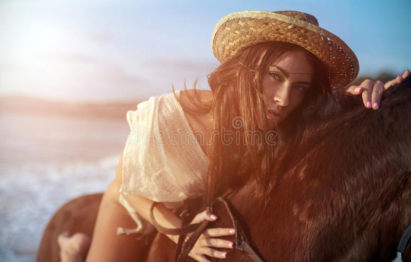 Closeup portrait of a young woman riding a majestick horse royalty free stock images