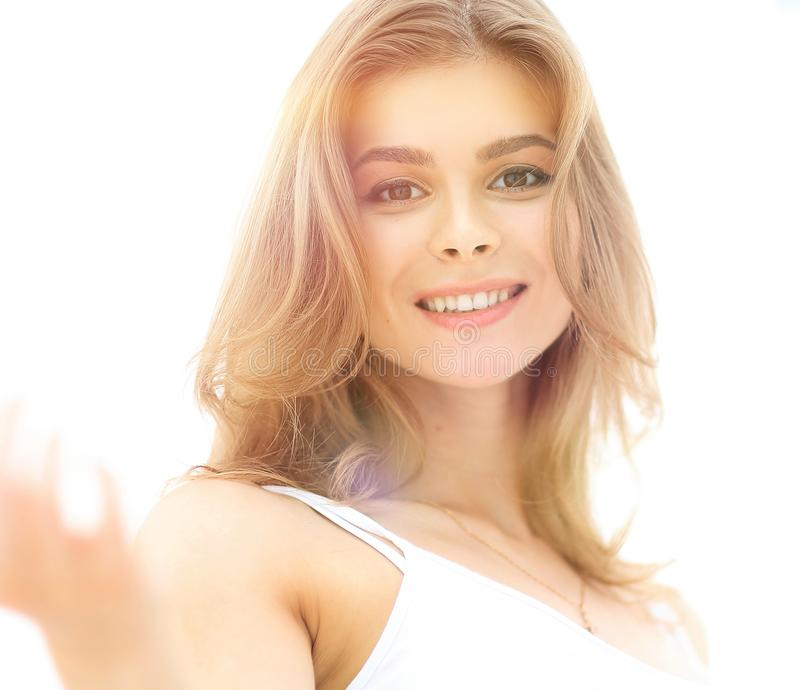 Closeup portrait of a young woman`s face with light make-up royalty free stock images