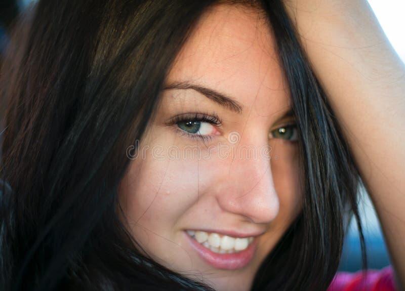 CloseUp portrait of Young Woman Smiling at Camera stock photos