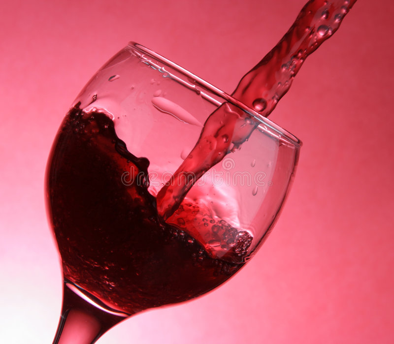 Closeup of pouring wine stock image