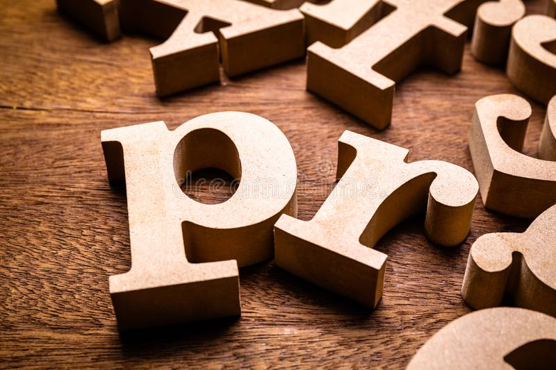 PR Public Relations Wood Letters. Closeup PR wood letters in the group of English alphabet on the table, abbreviation Public Relations stock image
