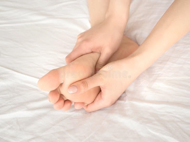 Closeup of pregnant woman hands doing foot massage. royalty free stock photos
