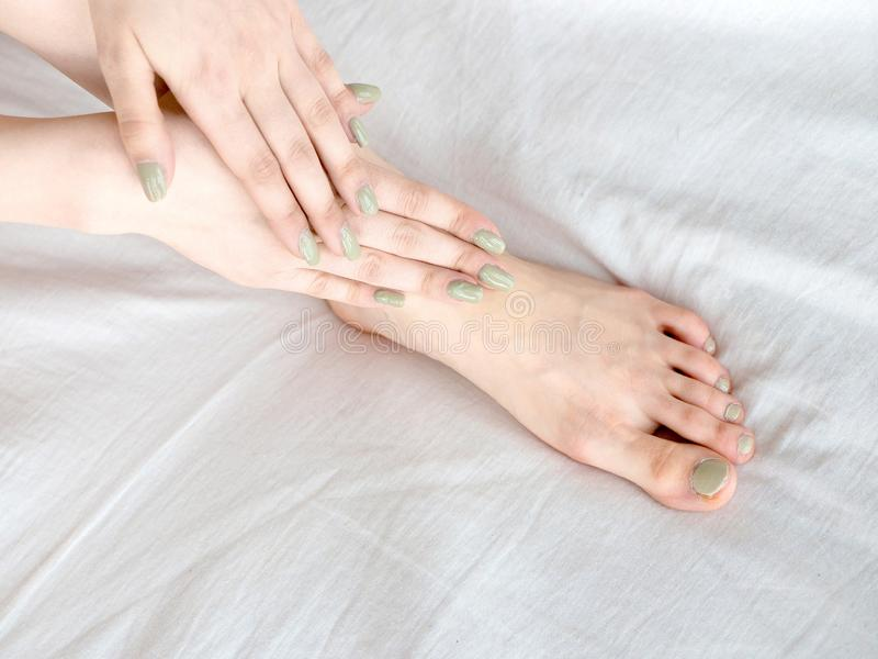 Closeup of pregnant woman hands doing foot massage royalty free stock image