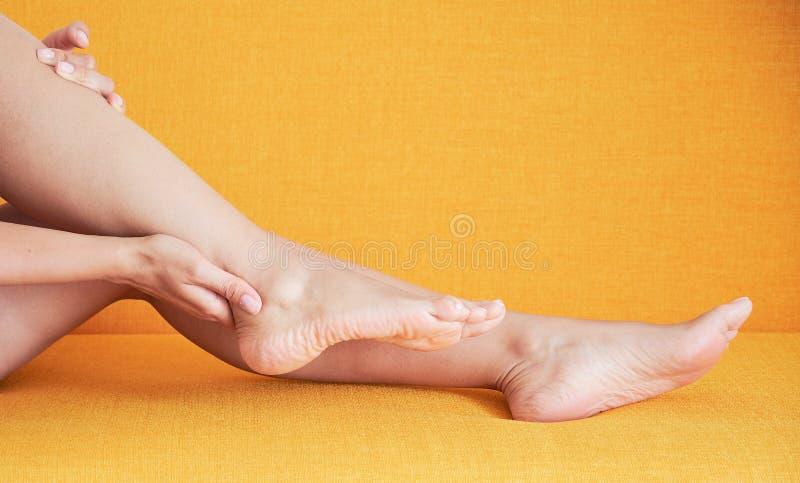 Closeup of pregnant woman hands doing foot massage stock photos