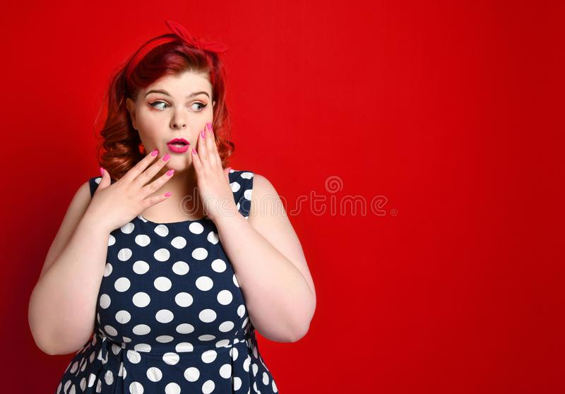 Pin up girl vintage. Beautiful woman pinup style portrait in retro dress and polka dot dress. Studio shot. royalty free stock photos