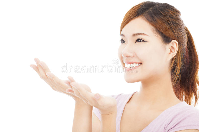 Closeup of pretty woman looking the direction of hand gesture stock photo
