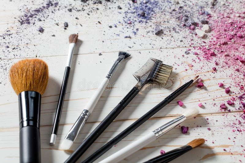 Closeup of professional makeup accessories with brushes and colors royalty free stock photography