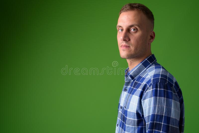 Closeup profile view of handsome hipster man looking at camera stock photography