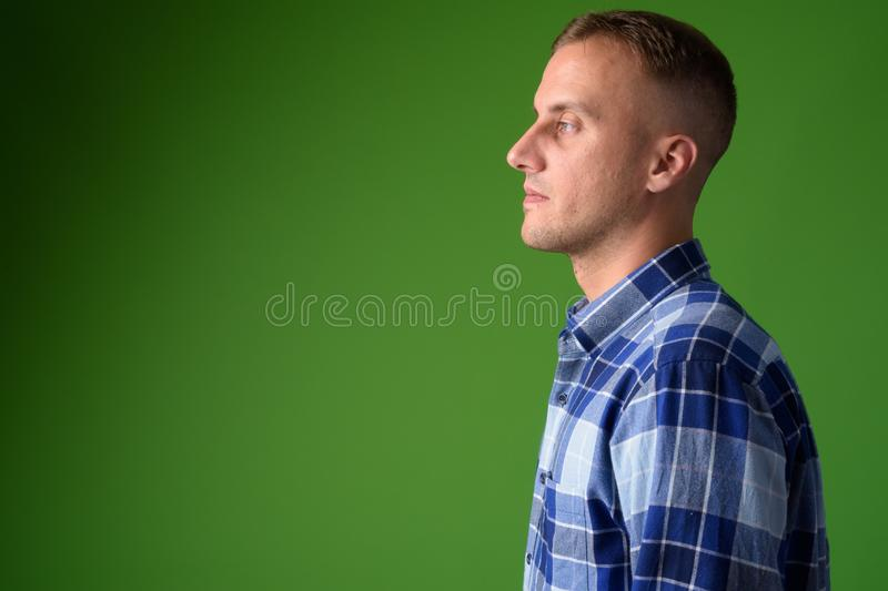 Closeup profile view of handsome hipster man stock photography