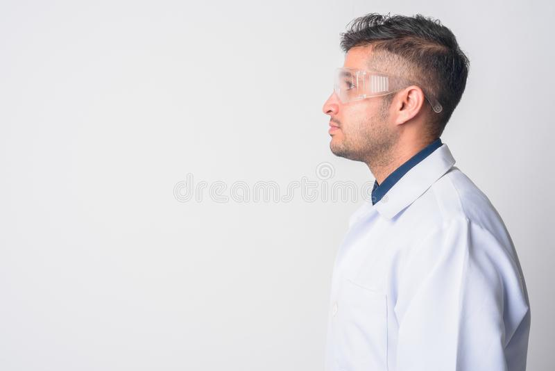 Closeup profile view of young Persian man doctor as scientist royalty free stock photos
