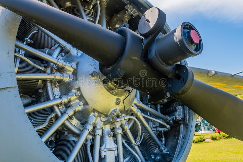 Closeup of propeller on radial engine. Closeup of propeller and radial engine of antique airplane on display in public park stock image