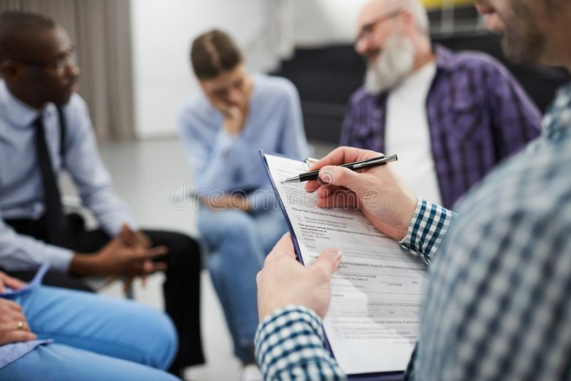 Closeup of Psychologist in Support Group royalty free stock images