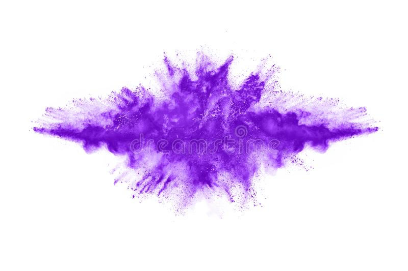 Closeup of a purple dust particle explosion isolated on white background. Powder explosion. Closeup of a purple dust particle explosion isolated on white stock image