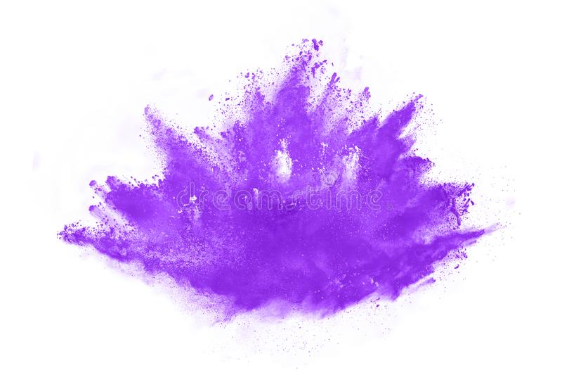 Closeup of a purple dust particle explosion isolated on white background. Powder explosion. Closeup of a purple dust particle explosion isolated on white royalty free stock images
