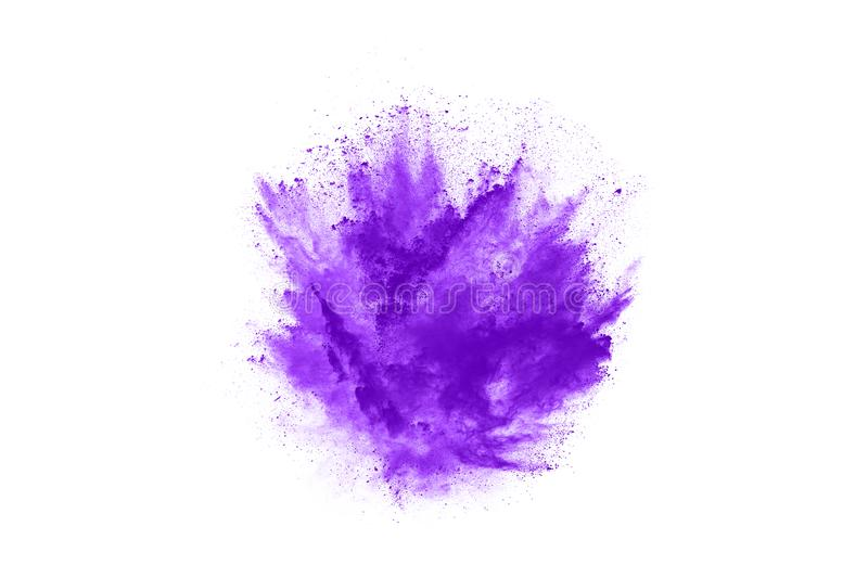 Closeup of a purple dust particle explosion isolated on white background. Powder explosion. Closeup of a purple dust particle explosion isolated on white royalty free stock photo
