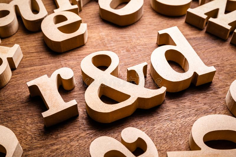 R&D Research and Development Wood Letters. Closeup R&D Research and Development wood letters in the group of English alphabet stock photography