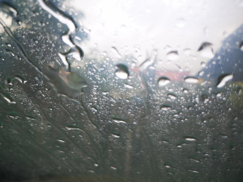 Raindrops on a window with darkness cloud. stock photography
