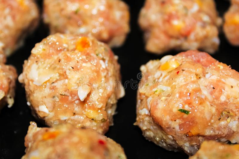 Closeup of a raw keto turkey meatball royalty free stock images