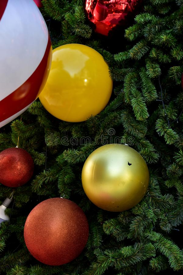 Closeup red bauble Christmas tree Gift Box balloon star royalty free stock images